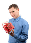 A young man offering a gift to you — Stock Photo
