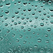 Water bubbles on a green glass — Stock Photo