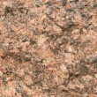Close up of a red granite texture — Stock Photo