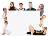 Group of young holding a blank board — Stock Photo