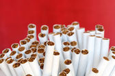 Cigarettes On Red — Stock Photo