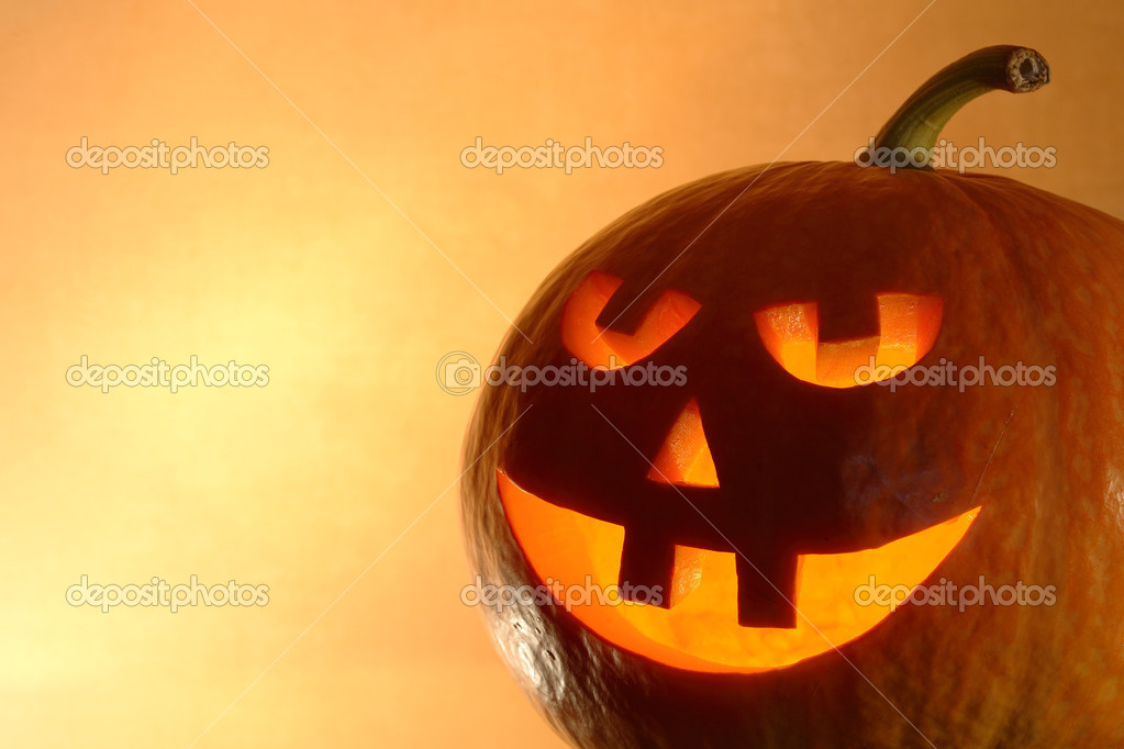 Closeup of glowing pumpkin head on yellow background with copy space — Stock Photo #3719061