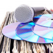 Compact discs and microphone on records - Stock Photo