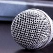 Microphone on black table - Stock Photo