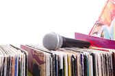 Microphone on stack of records — Stock Photo