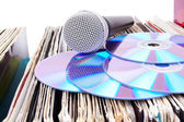 Compact discs and microphone on records — Stock Photo