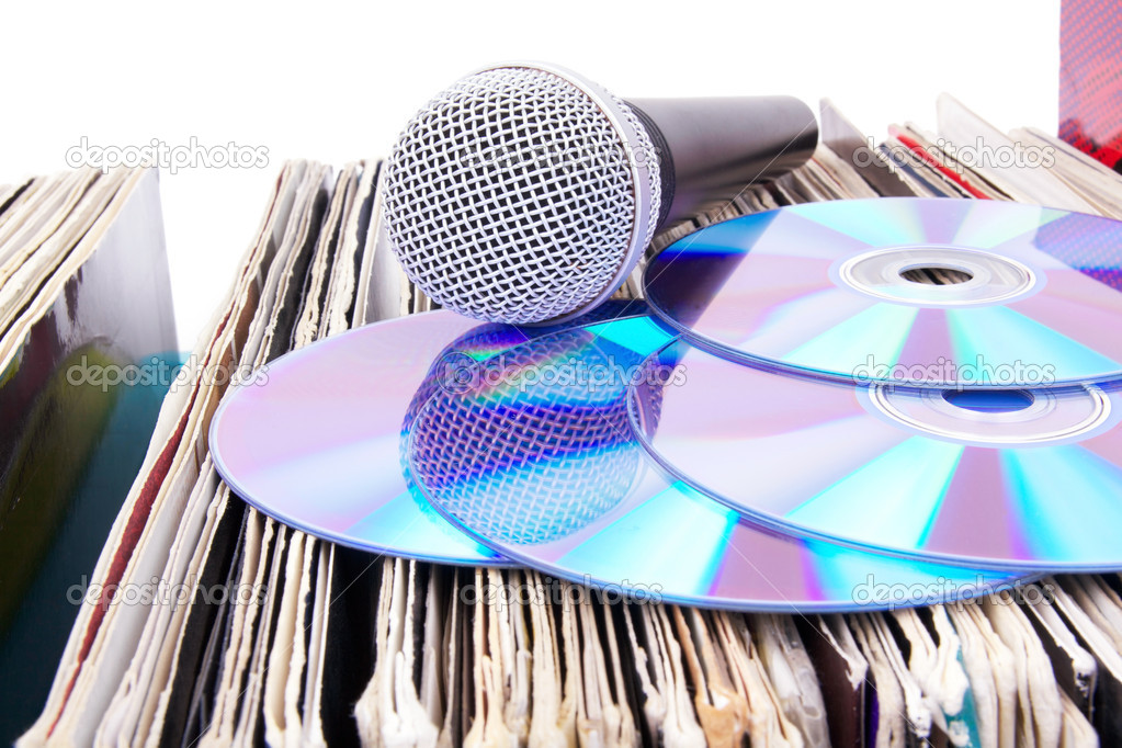 Compact discs and microphone on records, closed-up — Stock Photo #3196650