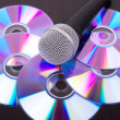 Microphone on dvd disc — Stock Photo