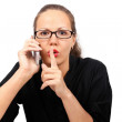Foto Stock: Businesswoman making shhh gesture