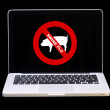 Foto Stock: Swine flu om laptop monitor