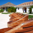 Wooden chairs near swimming pool — Stock Photo