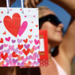 Stock Photo: Girl in bikini with present bag