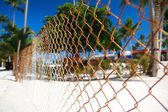 Grid fence in caribbean village — Stock Photo