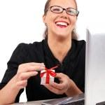 Happy businesswoman with present box — Stock Photo