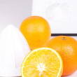 Squeezer and three oranges — Stock Photo