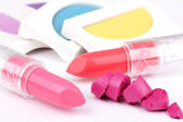 Lipsticks and eyeshadows — Stock Photo