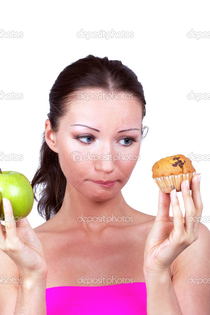 Woman with apple and cake in hands, closed-up portrait  Stock Photo #3489584