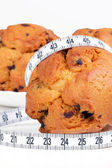 Cakes with measuring tape — Stock Photo