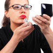 Businesswoman making make-up — Stock Photo