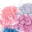 Stock Photo: Multicoloured crumbled eyeshadows on white
