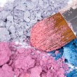 Professional make-up brush on crumbled eyeshadows — Stock Photo