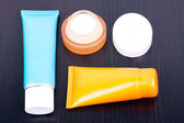 Tubes and box with cream — Stock Photo