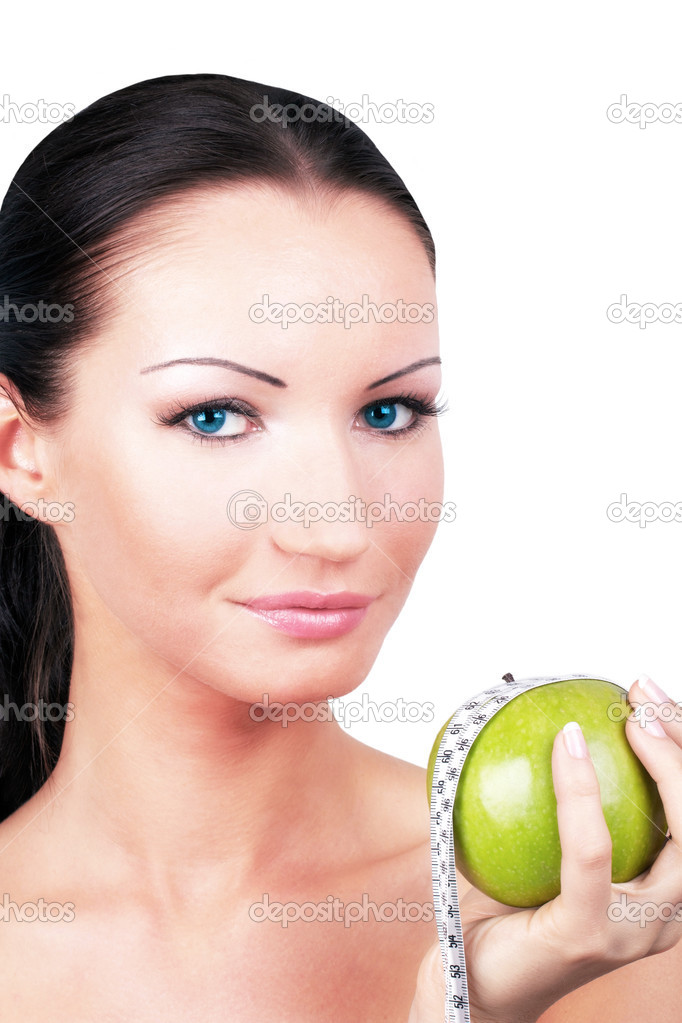 Woman with green apple rounded measuring tape, portrait  Stock Photo #3504207