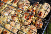 Chicken barbecue in metal grate — Photo