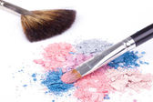 Crumbled color eyeshadows with make-up brush — Stock Photo