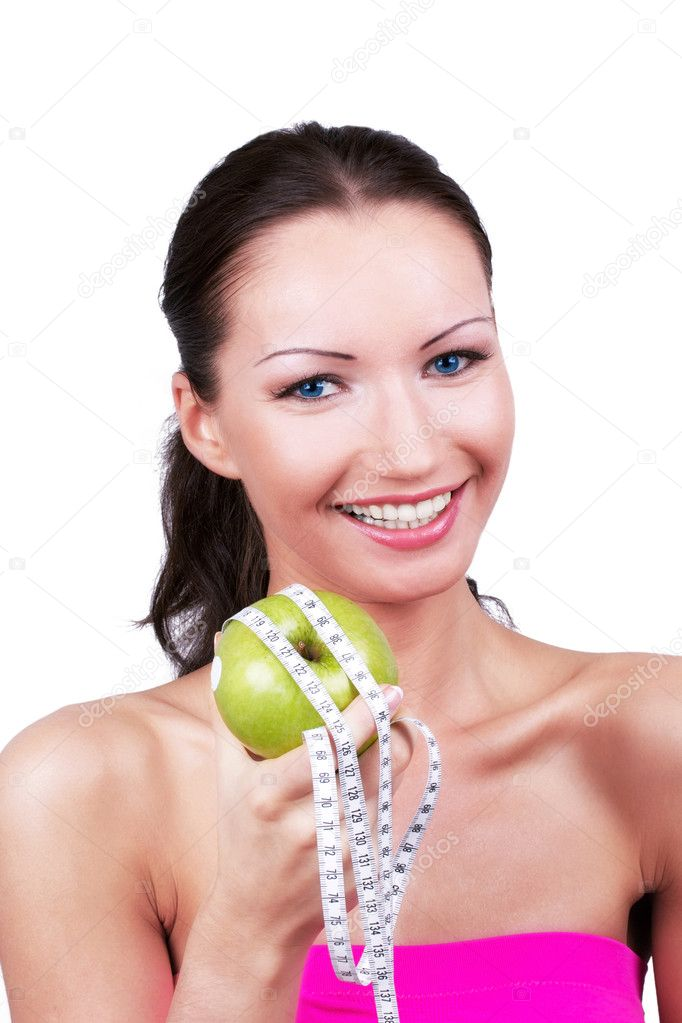 Happy woman with green apple rounded measuring tape, portrait  Stock Photo #3573328