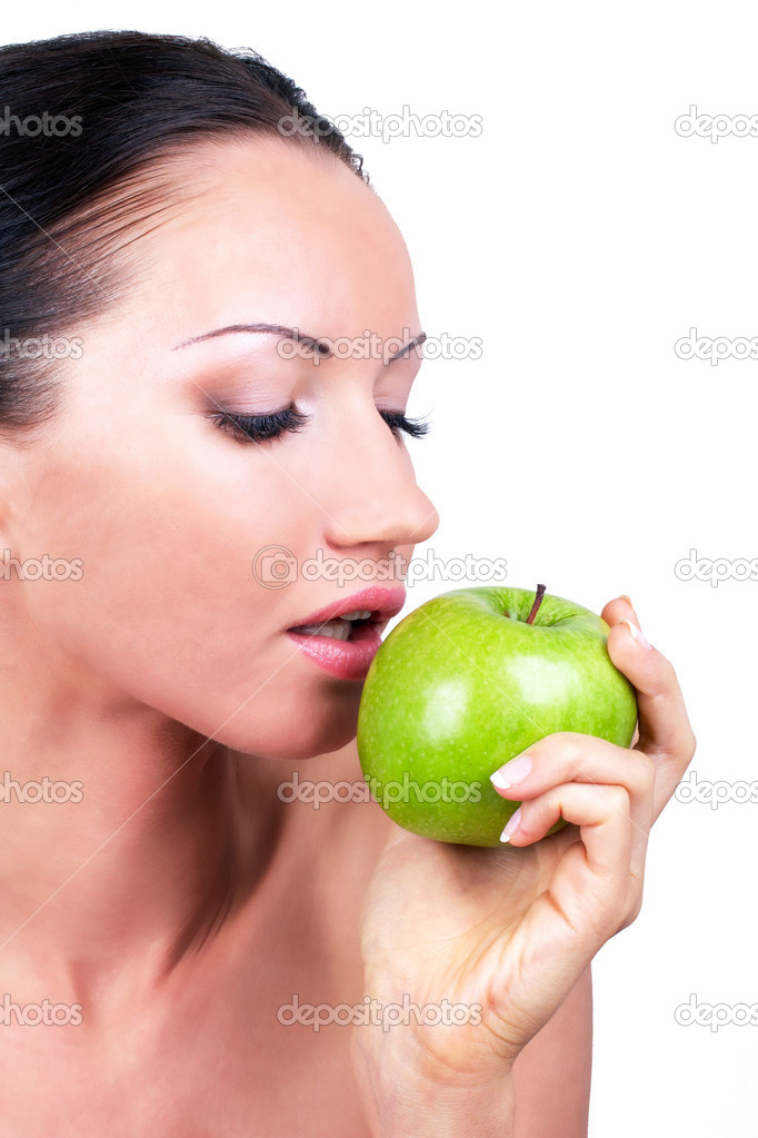 Beautiful woman with green apple in hand, closed-up on white — Stock Photo #3573345