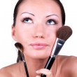 Woman with two professional make-up brushes — Stock Photo