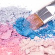 Professional make-up brush on colour crumbled eyeshadows - Stock Photo