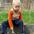 Young Boy digging in the ground — Stock Photo