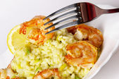 Risotto with fried prawns and avocado — Stock Photo