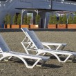 Plastic deck-chairs - Stock Photo