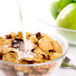 Cornflakes with milk and green apples - Stock Photo
