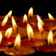 Flaming candles - Foto Stock
