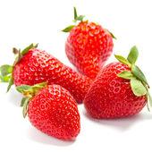 Four fresh strawberries — Stock Photo