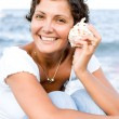 Woman with a cockleshell — Stock Photo