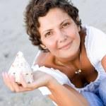 Woman on seacoast — Stock Photo #3700760