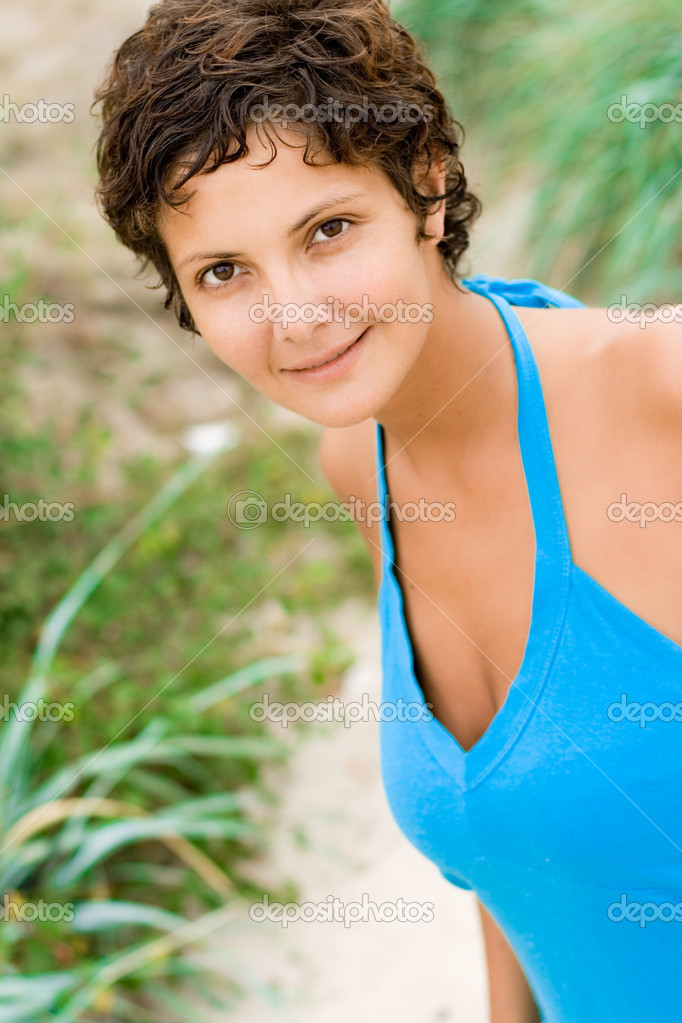 Closeup portrait of attractive brunet woman in blue — Stock Photo #3730341