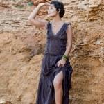Brunet woman in brown dress — Stock Photo