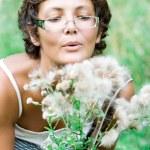 Brunet woman in a meadow — Stock Photo #3753108