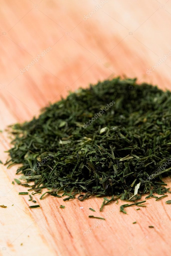 Heap of green tea on wooden background — Stock Photo #3806355