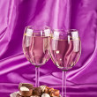 Two glasses of white wine and sweet — Stock Photo