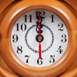 Stock Photo: Wooden hours with dial close up.