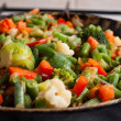 Vegetables on a frying pan. - Stock Photo