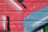Brick wall with graffiti. — Stock Photo