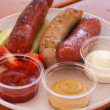 Royalty-Free Stock Photo: Fried sausage with sauce and vegetables.